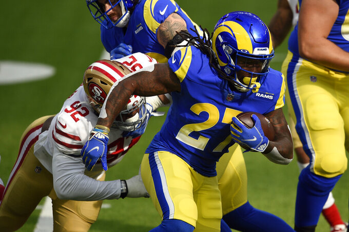 Los Angeles Rams running back Darrell Henderson carries against the San Francisco 49ers during the first half of an NFL football game Sunday, Nov. 29, 2020, in Inglewood, Calif. (AP Photo/Kelvin Kuo)