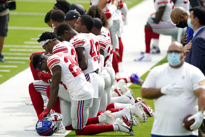 Members of the New York Giants kneel during the national anthem before an NFL football game against the Los Angeles Rams Sunday, Oct. 4, 2020, in Inglewood, Calif. (AP Photo/Ashley Landis )