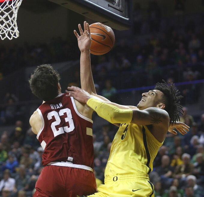 Stanford's Cormac Ryan, left, fouls Oregon's Miles Norris, right, during the first half of an NCAA college basketball game Sunday, Feb. 10, 2019, in Eugene, Ore. (AP Photo/Chris Pietsch)