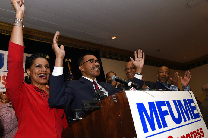 Kweisi Mfume, second from left, Democratic nominee for Maryland's 7th Congressional District, speaks at a victory party with his wife, Tiffany, left, Tuesday, Feb. 4, 2020, in Baltimore. (AP Photo/Gail Burton)