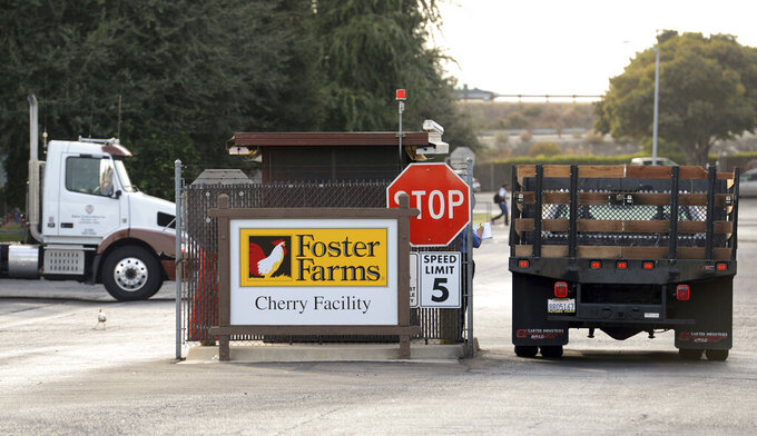 FILE - In this Oct. 8, 2013, file photo, is an entryway into a Foster Farms chicken plant in Fresno, Calif. Local health officials gave a heads-up to a California chicken processing plant about a state inspection during the largest known COVID-19 workplace outbreak in Fresno County, The Fresno Bee reported, Wednesday, March 17, 2021, citing emails obtained through the Public Records Act. Hundreds were infected in the outbreak late last year at a Foster Farms plant in Fresno and at least five workers have died. (AP Photo/The Fresno Bee, Craig Kohlruss)