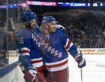 New York Rangers Boo Nieves (24) celebrates with teammate Kevin Shattenkirk after Nieves scored to tie the game with the Tampa Bay Lightning during the second period of an NHL hockey game Wednesday, Feb. 27, 2019, at Madison Square Garden in New York. (AP Photo/Craig Ruttle)
