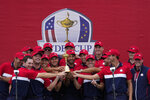 Team USA players pose with the trophy after the Ryder Cup matches at the Whistling Straits Golf Course Sunday, Sept. 26, 2021, in Sheboygan, Wis. (AP Photo/Ashley Landis)