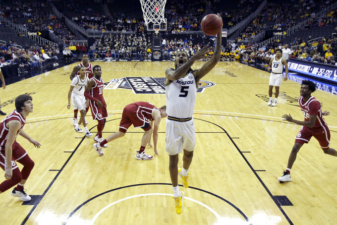 Missouri forward Mitchell Smith (5) shoots during the first half of an NCAA college basketball game against Oklahoma, Tuesday, Nov. 26, 2019, in Kansas City, Mo. (AP Photo/Charlie Riedel)