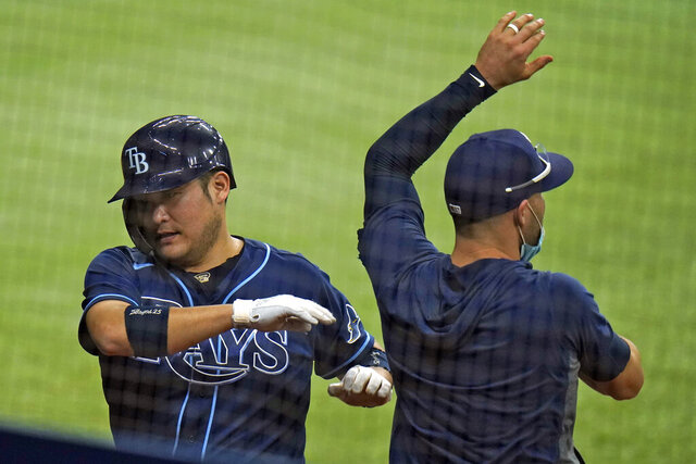 Tampa Bay Rays' Yoshi Tsutsugo, of Japan,, left, celebrates with Kevin Kiermaier after scoring on a two-run single by Joey Wendle off Philadelphia Phillies relief pitcher Hector Neris during the eighth inning of a baseball game Friday, Sept. 25, 2020, in St. Petersburg, Fla. (AP Photo/Chris O'Meara)