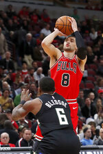 Chicago Bulls' Zach LaVine (8) shoots over Milwaukee Bucks' Eric Bledsoe during the first half of an NBA basketball game Monday, Nov. 18, 2019, in Chicago. (AP Photo/Charles Rex Arbogast)