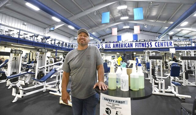 Larry Danko at his business Monday morning, May 25, 2020 in Plains, Pa. After being shut down since March, Larry Danko defied a state order and reopened his fitness center in Plains Twp. at 5 a.m. Tuesday morning even though Luzerne County remains in the red phase. Police and state regulators are cracking down on a handful of Pennsylvania businesses that are supposed to remain shut down during the pandemic but have instead thrown open their doors. (Mark Moran/The Citizens' Voice via AP)