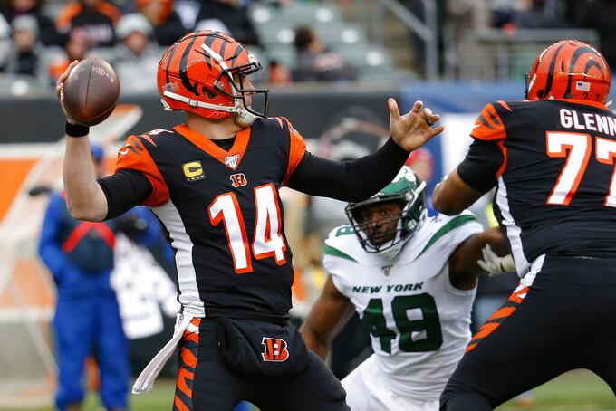 Cincinnati Bengals quarterback Andy Dalton (14) passes during the first half of an NFL football game against the New York Jets, Sunday, Dec. 1, 2019, in Cincinnati. (AP Photo/Frank Victores)