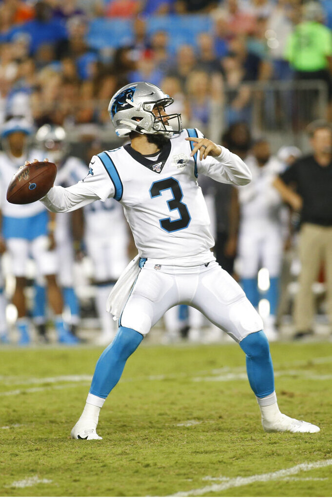Carolina Panthers quarterback Will Grier (3) looks for a reciever against the Buffalo Bills during the first half an NFL preseason football game, Friday, Aug. 16, 2019, in Charlotte, N.C. (AP Photo/Brian Blanco)