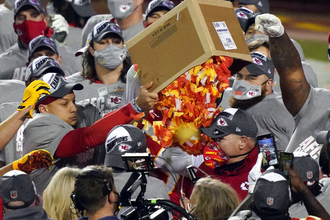 Kansas City Chiefs players dump a box of confetti on head coach Andy Reid after the AFC championship NFL football game against the Buffalo Bills, Sunday, Jan. 24, 2021, in Kansas City, Mo. The Chiefs won 38-24. (AP Photo/Jeff Roberson)