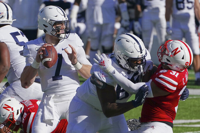 Penn State quarterback Will Levis (7) looks to throw as Penn State tight end Grayson Kline (89) blocks Nebraska linebacker Collin Miller (31) during the first half of an NCAA college football game in Lincoln, Neb., Saturday, Nov. 14, 2020. (AP Photo/Nati Harnik)