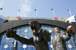 "FILE - In this Sept. 17, 2017, file photo, a bronze statue of Carolina Panthers owner Jerry Richardson and the team mascot is shown before an NFL football game between the Carolina Panthers and the Buffalo Bills, in Charlotte, N.C. The statue of former Carolina Panthers owner Jerry Richardson, which had stood in front of the team's stadium since it opened nearly 25 years ago, was removed Wednesday, June 10, 2020. ""We were aware of the most recent conversation surrounding the Jerry Richardson statue and are concerned there may be attempts to take it down,"" the team said in a statement. ""We are moving the statue in the interest of public safety."" (AP Photo/Jason E. Miczek, File)"