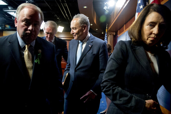 From left, Rep. Mike Doyle, D-Pa., Sen. Ed Markey, D-Mass., Senate Minority Leader Sen. Chuck Schumer of N.Y., and Sen. Maria Cantwell, D-Wash., leave a news conference on Capitol Hill in Washington, Wednesday, May 16, 2018, after the Senate passed a resolution to reverse the FCC decision to end net neutrality. (AP Photo/Andrew Harnik)