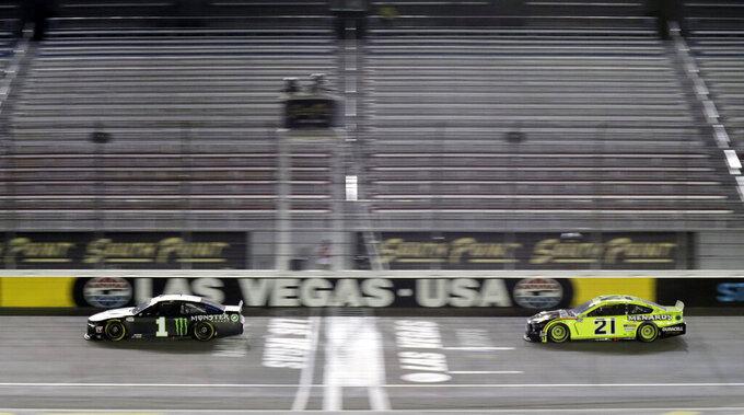 Kurt Busch (1) leads Matt DiBenedetto during a NASCAR Cup Series auto race Sunday, Sept. 27, 2020, in Las Vegas. (AP Photo/Isaac Brekken)
