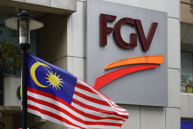 "A Malaysian national flag is on display outside FGV Holdings Berhad, one of Malaysia's largest palm oil companies, in Kuala Lumpur, Thursday, Oct. 1, 2020. Malaysian palm oil producer FGV Holdings Berhad vowed Thursday to ""clear its name"" after the U.S. banned imports of its palm oil over allegations of forced labor and other abuses. (AP Photo/Vincent Thian)"
