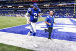 Indianapolis Colts quarterback Carson Wentz (2) runs off the field following a 28-16 loss to the Seattle Seahawks in an NFL football game in Indianapolis, Sunday, Sept. 12, 2021. (AP Photo/Charlie Neibergall)