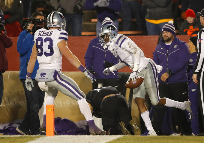 Kansas State wide receiver Isaiah Zuber celebrates with teammate Dalton Schoen, left, after catching a 6-yard touchdown pass during the first half of an NCAA college football game against Iowa State, Saturday, Nov. 24, 2018, in Ames, Iowa. (AP Photo/Charlie Neibergall)