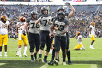 Purdue running back King Doerue (22) celebrates a touchdown against Minnesota with offensive lineman Eric Miller (74) and tight end Payne Durham (87) during the second half of an NCAA college football game in West Lafayette, Ind., Saturday, Sept. 28, 2019. Minnesota defeated Purdue 38-31. (AP Photo/Michael Conroy)