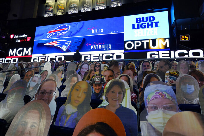 Cutout photos of people, including first responders and healthcare workers, sit in seats in Gillette Stadium before an NFL football game between the New England Patriots and the Buffalo Bills, Monday, Dec. 28, 2020, in Foxborough, Mass. (AP Photo/Charles Krupa)