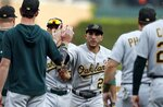 Oakland Athletics center fielder Ramon Laureano, center, leads teammates in celebration of their win over the Detroit Tigers in a baseball game, Saturday, May 18, 2019, in Detroit. (AP Photo/Carlos Osorio)
