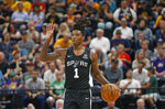 San Antonio Spurs guard Lonnie Walker lV brings the ball up during the second half of an NBA summer league basketball game against the Utah Jazz on Wednesday, July 3, 2019, in Salt Lake City. (AP Photo/Rick Bowmer)