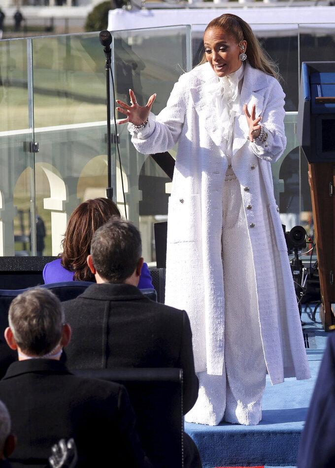 Singer Jennifer Lopez greets Vice President-elect Kamala Harris during President-elect Joe Biden's inauguration, Wednesday, Jan. 20, 2021, at the U.S. Capitol in Washington. (Jonathan Ernst/Pool Photo via AP)