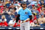 FILE - In this March 2, 2020, file photo, Miami Marlins' Isan Diaz bats during the second inning of a spring training baseball game against the Washington Nationals in West Palm Beach, Fla. The Marlins received no new positive results in their latest round of coronavirus testing, a person familiar with the situation said Saturday, but second baseman Isan Diaz decided to opt out of the season. (AP Photo/Jeff Roberson, File)