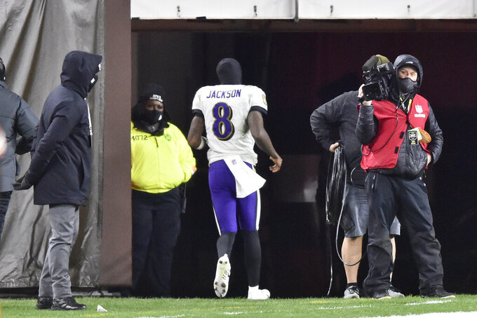 Baltimore Ravens quarterback Lamar Jackson (8) runs to the locker room during the second half of an NFL football game against the Cleveland Browns, Monday, Dec. 14, 2020, in Cleveland. (AP Photo/David Richard)