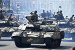 Tanks ride along Khreshchatyk Street, during a military parade to celebrate Independence Day in Kiev, Ukraine, Tuesday, Aug. 24, 2021. (AP Photo/Efrem Lukatsky)