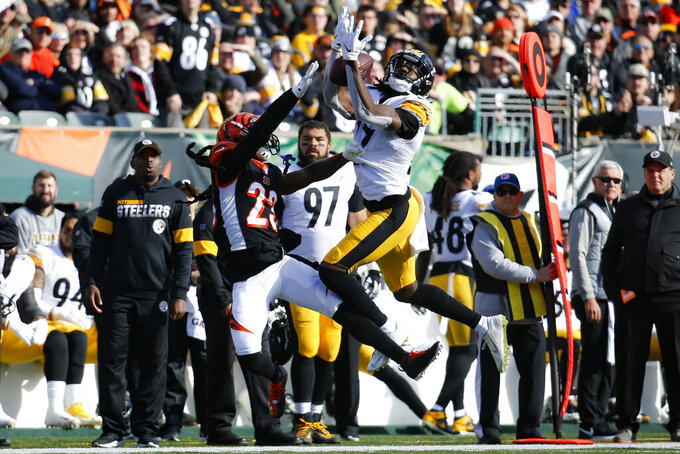 Pittsburgh Steelers wide receiver Deon Cain (17) catches a pass against Cincinnati Bengals cornerback B.W. Webb (23) during the first half an NFL football game, Sunday, Nov. 24, 2019, in Cincinnati. (AP Photo/Frank Victores)