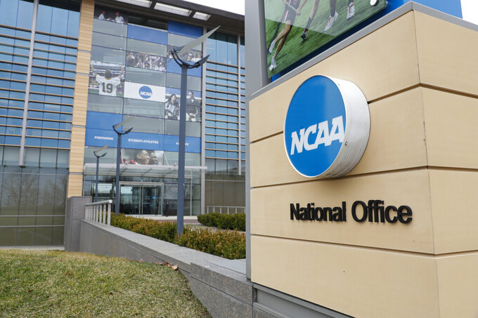FILE - The NCAA headquarters in Indianapolis is shown in this Thursday, March 12, 2020, file photo. The Associated Press has learned that the NCAA has not tested players for performance-enhancing drugs while they've been at March Madness and other recent college championships. Three people familiar with testing protocols tell AP full-scale testing has not resumed since the coronavirus pandemic shut down college sports a year ago.  (AP Photo/Michael Conroy, File)