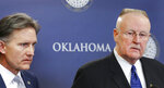 Oklahoma Attorney General Mike Hunter, left, and Joe Allbaugh, the director of the Oklahoma Corrections Department, listen during a news conference Wednesday, March 14, 2018, at the Capitol in Oklahoma City. After trying unsuccessfully for months to obtain lethal injection drugs, Oklahoma officials said Wednesday they plan to use nitrogen gas to execute inmates once the state resumes using the death penalty, marking the first time a U.S. state would use the gas to carry out capital punishment.  (Jim Beckel/The Oklahoman via AP)