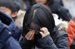 A participant wipes away tears during a weekly rally near the Japanese Embassy in Seoul, South Korea, Wednesday, Jan. 30, 2019. Hundreds of South Koreans are mourning the death of a former sex slave for the Japanese military during World War II by demanding reparations from Tokyo over wartime atrocities. (AP Photo/Lee Jin-man)