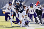 BYU running back Tyler Allgeier (25) runs the ball for a first down past North Alabama cornerback Will Singleton, bottom, defensive end Tyler Antkowiak (41) and linebacker Christon Taylor (25) in the second quarter during an NCAA college football game Saturday, Nov. 21, 2020, in Provo, Utah. (AP Photo/Jeff Swinger, Pool)