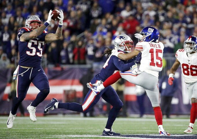New England Patriots defensive end John Simon (55) intercepts a pass intended for New York Giants wide receiver Golden Tate (15) in the first half of an NFL football game, Thursday, Oct. 10, 2019, in Foxborough, Mass. (AP Photo/Elise Amendola)