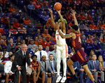 Clemson's Shelton Mitchell (4) shoots a 3-pointer over Virginia Tech's Nickeil Alexander-Walker during the first half of an NCAA college basketball game Saturday, Feb. 9, 2019, in Clemson, S.C.. (AP Photo/Richard Shiro)