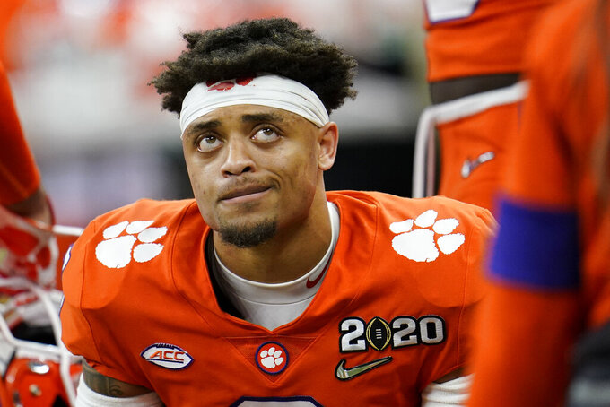 Clemson cornerback A.J. Terrell sits on the bench during the second half of a NCAA College Football Playoff national championship game against LSU, Monday, Jan. 13, 2020, in New Orleans. (AP Photo/David J. Phillip)