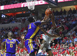 LSU forward Kavell Bigby-Williams (11) blocks a shot by Mississippi guard Blake Hinson, right, during the first half of an NCAA college basketball game in Oxford, Miss., Tuesday, Jan. 15, 2019. (AP Photo/Thomas Graning)