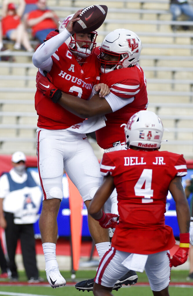 Houston quarterback Clayton Tune, left, celebrates his touchdown with offensive lineman Keenan Murphy, right, during the first half of an NCAA college football game against South Florida, Saturday, Nov. 14, 2020, in Houston. (AP Photo/Eric Christian Smith)