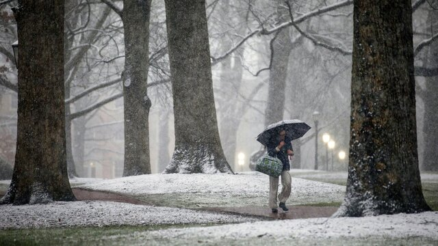 Snow falls on McCorkle Place on the campus of UNC-Chapel Hill Thursday evening, Feb. 20, 2020, in Chapel Hill, N.C. Snow began falling in central North Carolina in the afternoon as temperatures dropped quickly. Accumulations of 2-3 inches are expected. (Julia Wall/The News & Observer via AP)