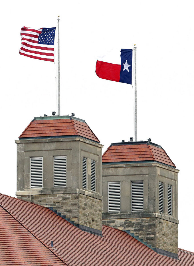 A Texas state flag flies in place of a Kansas University game day flag atop of KU's Fraser Hall during the first half of an NCAA college football game between Kansas and Texas in Lawrence, Kan., Friday, Nov. 23, 2018. Pranksters replaced the KU flag with a Texas state flag. (AP Photo/Orlin Wagner)