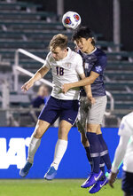 Virginia's Axel Gunnarsson (18) and Georgetown's Daniel Wu, right, jump for a ball during the first half of the NCAA college Soccer Championship in Cary, N.C., Sunday, Dec. 15, 2019. (AP Photo/Ben McKeown)