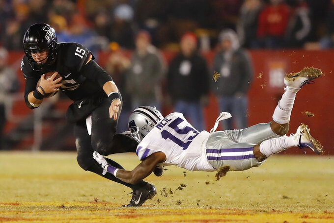 Iowa State quarterback Brock Purdy (15) breaks a tackle by Kansas State defensive back Walter Neil Jr. (15) during the second half of an NCAA college football game, Saturday, Nov. 24, 2018, in Ames, Iowa. Iowa State won 42-38. (AP Photo/Charlie Neibergall)