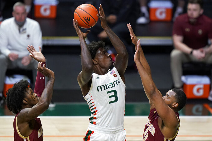 Miami center Nysier Brooks (3) shoots against Boston College forwards CJ Felder, left, and Frederick Scott during the first half of an NCAA college basketball game, Friday, March 5, 2021, in Coral Gables, Fla. (AP Photo/Wilfredo Lee)