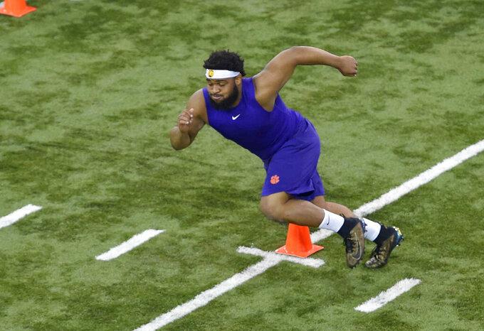 Clemson's Christian Wilkins runs drills during NFL Pro Day, Thursday, March 14, 2019, in Clemson, S.C. (AP Photo/Richard Shiro)