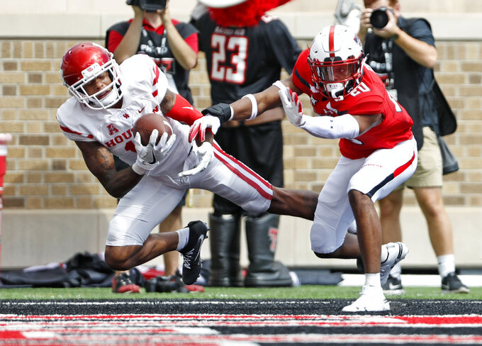 Houston's Raelon Singleton (15) catches a touchdown pass in front of Texas Tech's Adrian Frye (20) during an NCAA college football game Saturday, Sept. 15, 2018, in Lubbock, Texas. (Brad Tollefson/Lubbock Avalanche-Journal via AP)
