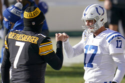 Pittsburgh Steelers quarterback Ben Roethlisberger (7) greets Indianapolis Colts quarterback Philip Rivers (17) as the teams warm up before an NFL football game Sunday, Dec. 27, 2020, in Pittsburgh. (AP Photo/Gene J. Puskar)