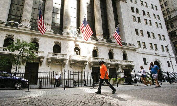 FILE- People walk by the New York Stock Exchange, Tuesday, July 21, 2020.  Stocks are rising again on Wall Street, and the S&P 500 is ticking closer to its record high as it tries for a fourth straight gain. The S&P 500 was 0.6% higher after the first 30 minutes of Wednesday, Aug. 5,  trading, following up on gains in European markets and across much of Asia. (AP Photo/Mark Lennihan)