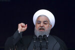 In this Monday, Feb. 11, 2019, photo, Iranian President Hassan Rouhani speaks during a ceremony celebrating the 40th anniversary of the Islamic Revolution, at the Azadi, Freedom, Square in Tehran, Iran. Lashed by criticism over his collapsing nuclear deal, Iran's President Rouhani faces an uncertain future amid a renewed hard-line effort to drive him from office years before his elected term ends. Iranian presidents typically see their popularity erode during their second four-year terms. But analysts say Rouhani is particularly vulnerable because of the economic crisis assailing the country's rial currency, which has hurt ordinary Iranians and emboldened critics to call for his ouster. (AP Photo/Vahid Salemi)