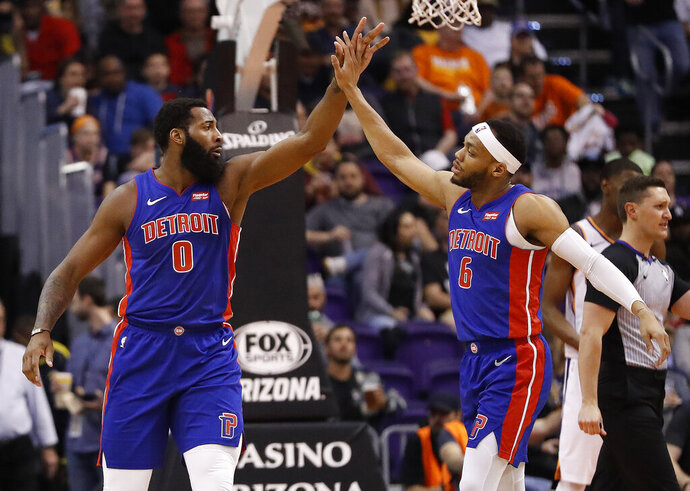 Detroit Pistons center Andre Drummond (0) and guard Bruce Brown (6) celebrate during the second half of the team's NBA basketball game against the Phoenix Suns, Thursday, March 21, 2019, in Phoenix. (AP Photo/Matt York)
